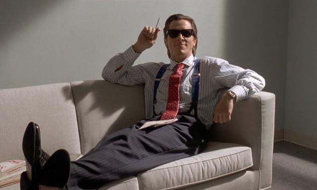 American-Psycho_Christian-Bale-sofa-braces_crop_cap
